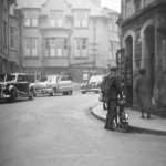 A man with a pushbike on New Street in Keswick