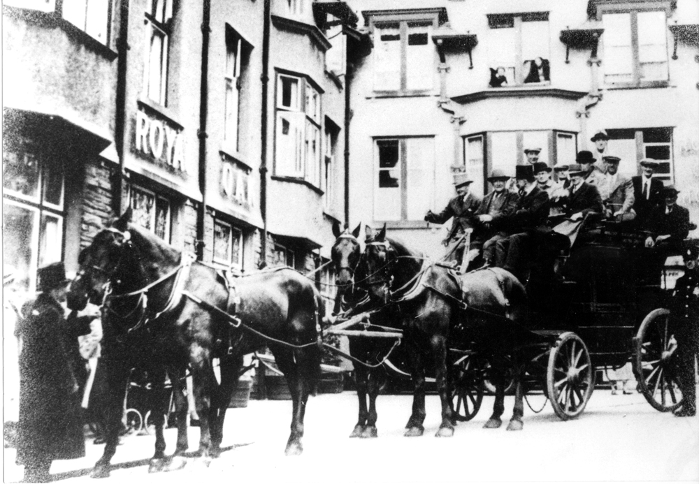 A magnificent horse-drawn coach arriving in Keswick