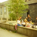 A family relax in the courtyard on a sunny Lake District day