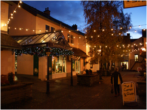 Twinkling lights and a setting sun make winter afternoons a shopping delight
