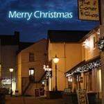 Street lamps light the courtyard on a dark Christmas night.