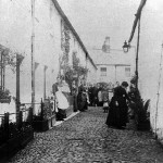 An old photograph of a cobblestone street in Keswick