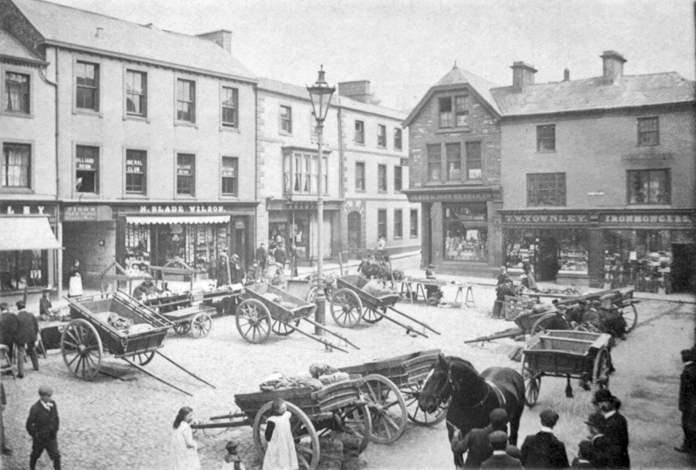 An array of horse drawn coaches parked like cars in the courtyard